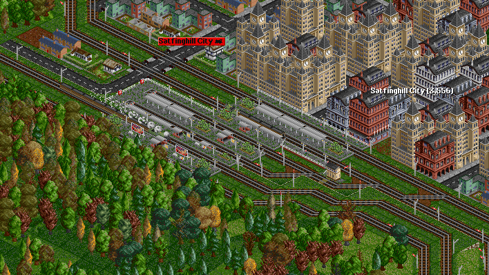 The train rumbles through Satfinghall City. A stopper for the older route is seen in platform 2.