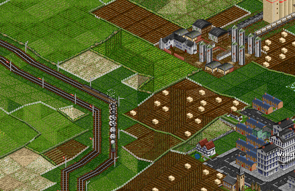 The train continues to decend. Two agricultural trains can be seen in the farm station.